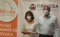 Responsables de Oximesa y 'Heroes hasta la Medula' durante una iniciativa conjunta.