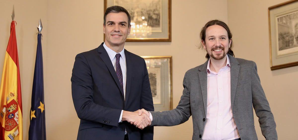 Pedro Sánchez y Pablo Iglesias durante la firma del preacuerdo para un gobierno de coalición PSOE-Podemos. (Foto. Flickr PSOE)