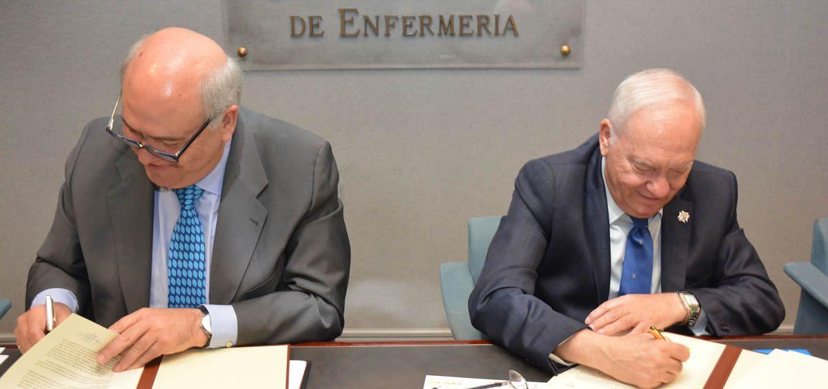 De izquierda a derecha: Ángel Fernández y Florentino Pérez Raya, durante la firma de su acuerdo de colaboración