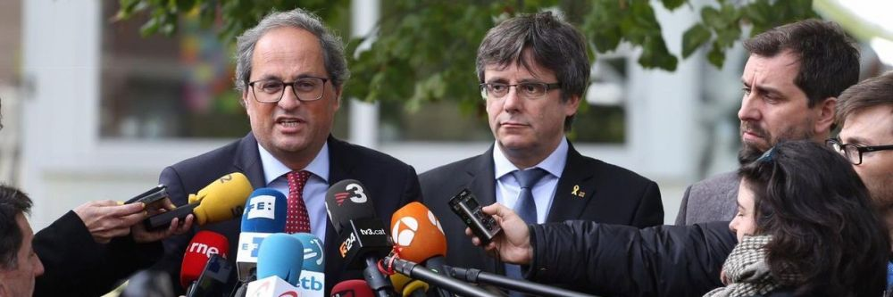 Quim Torra, presidente de la Generalitat de Cataluña, junto al expresident, Carles Puigdemont, y al exconsejero de Salud, Toni Comín.